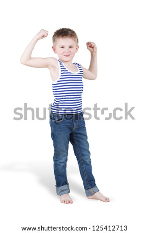 Smiling boy strains biceps and shows how strong he is - stock photo