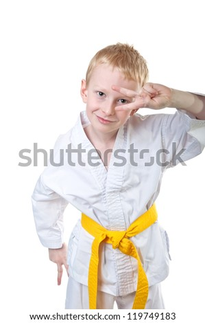 Smiling boy wearing tae kwon do uniform and having fun - stock photo