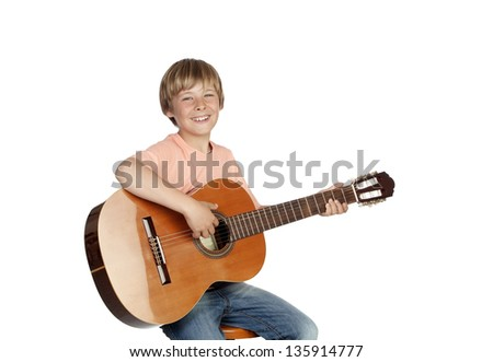 Smiling boy with a guitar isolated on white background - stock photo