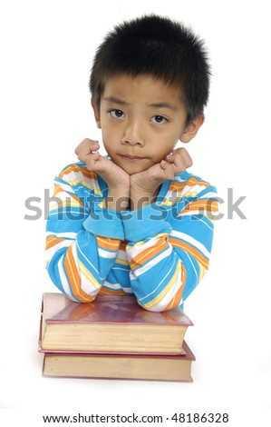 Smiling boy with set of books - stock photo