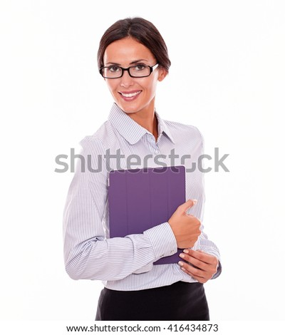 Smiling brunette businesswoman with glasses carrying a tablet, wearing her straight hair tied back and a button down shirt, looking at the camera, on a white background - stock photo
