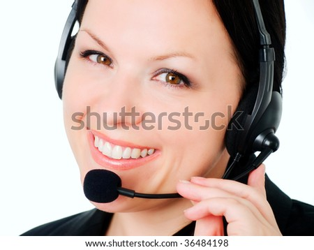 smiling brunette woman talking by headphone - stock photo