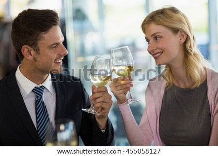 Smiling business colleagues toasting beer glass in a restaurant - stock photo