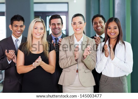 smiling business group applauding for good news - stock photo