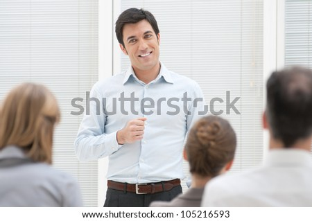 Smiling business man have a speech at business presentation - stock photo