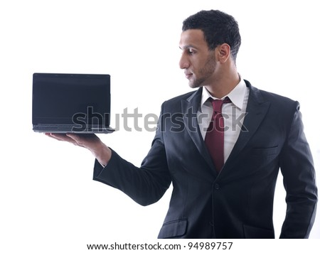Smiling business man hold and work on mini laptop comuter   Isolated on white background in studio - stock photo