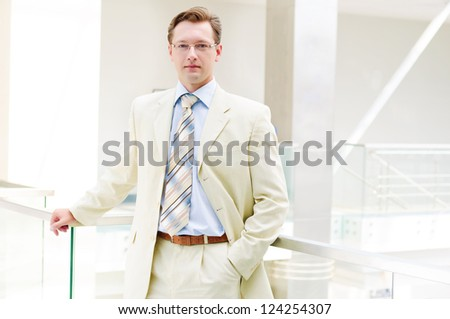 Smiling business man, looking to the camera - stock photo