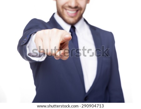 Smiling business man pointing the finger at you, isolated on white background - stock photo