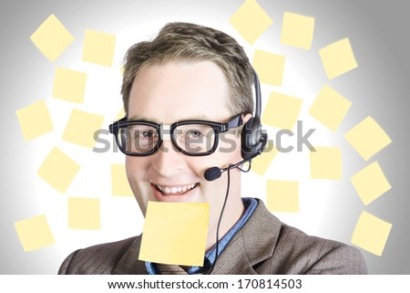 Smiling business man wearing customer support headset with call back sticky note on face. Communication copyspace - stock photo