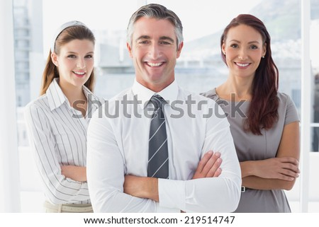 Smiling business man with colleagues in the office - stock photo