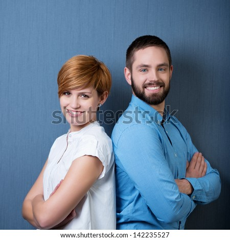 Smiling Business People Back to Back with blue background - stock photo