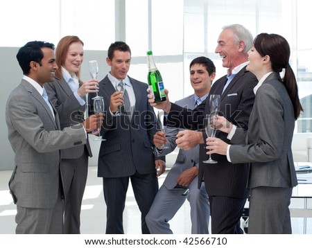 Smiling business people celebrating a success with Champagne - stock photo