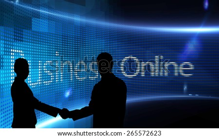 Smiling business people shaking hands while looking at the camera against business online on digital screen - stock photo