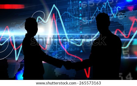Smiling business people shaking hands while looking at the camera against stocks and shares on black background - stock photo