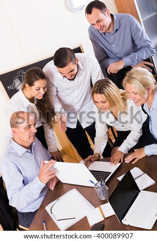 Smiling business people 30-35 years old during conference call indoors - stock photo