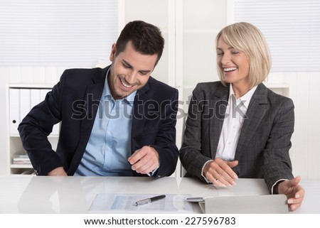 Smiling business team having fun in the office: daily hustle concept. - stock photo