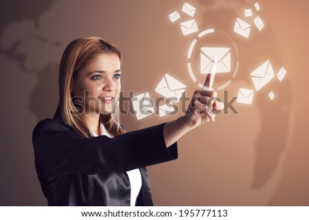 Smiling business woman checking her email or inbox. - stock photo