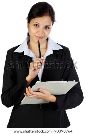 Smiling business woman holding clipboard - stock photo