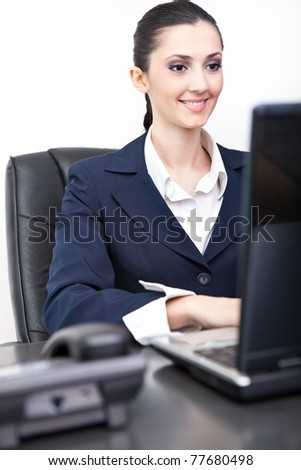 smiling business woman in  her chancellery working - stock photo