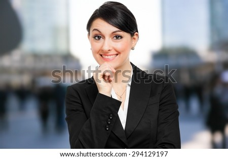 Smiling business woman portrait - stock photo