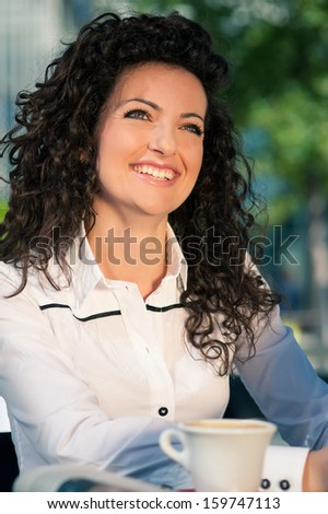 Smiling business woman portrait outdoors. - stock photo