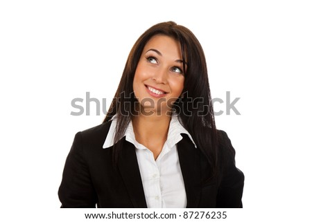 Smiling business woman standing think looking up. Isolated over white background - stock photo