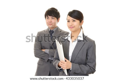 Smiling businessman and businesswoman - stock photo