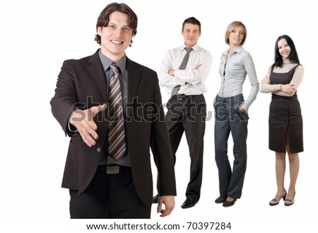 Smiling businessman  and his team ready to make a deal, against white background - stock photo