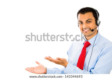 Smiling businessman / customer service representative talking on headset against a white background  - stock photo