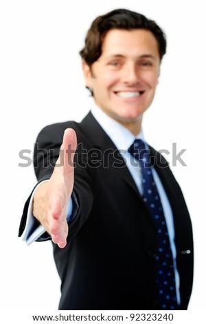 Smiling businessman extends his arm for a congratulatory handshake - stock photo