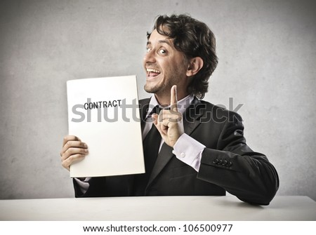 Smiling businessman holding a contract - stock photo