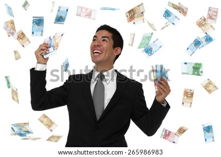 Smiling businessman holding Euro in a money rain storm. looking up to the sky. concept. - stock photo