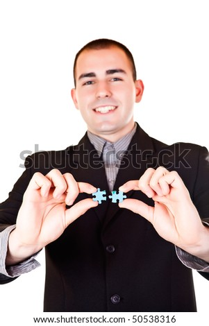 smiling businessman holding two pieces of blue puzzle - stock photo