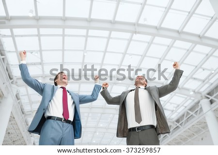 Smiling businessman in office - stock photo