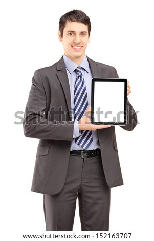 Smiling businessman in suit showing a tablet isolated on white background - stock photo
