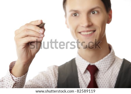 Smiling businessman is writing on a virtual whiteboard. Focus is on the hand and pen - stock photo