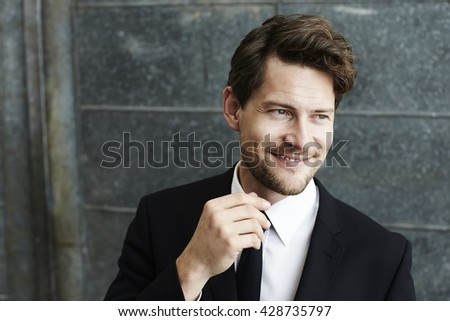 Smiling businessman looking away - stock photo
