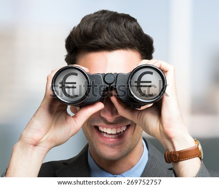 Smiling businessman looking to a Euro symbol through binoculars - stock photo