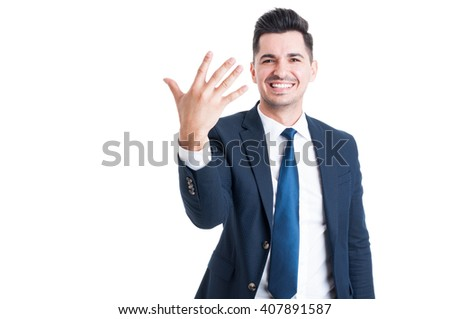 Smiling businessman or sales man showing number five isolated on white background - stock photo