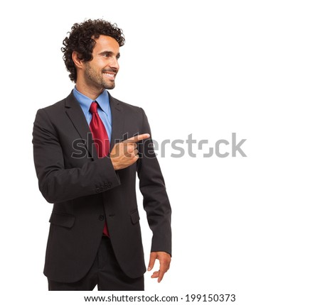 Smiling businessman pointing his finger to the copy-space. Isolated on a white background - stock photo