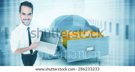 Smiling businessman pointing his laptop against composite image of cloud computing drawer - stock photo