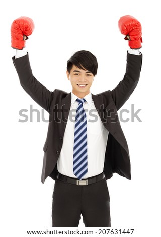 smiling businessman raises hands with gloves  - stock photo