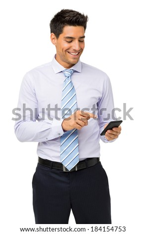 Smiling businessman reading text message on smart phone against white background. Vertical shot. - stock photo