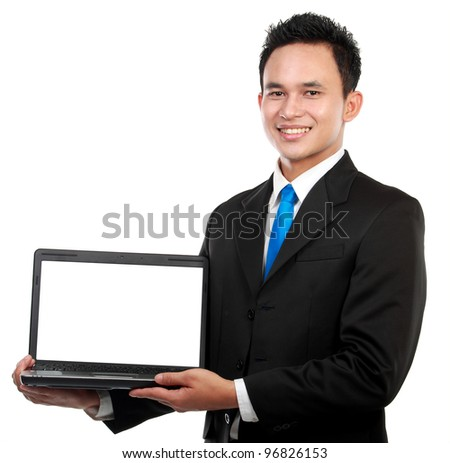 Smiling businessman showing a blank laptop against a white background - stock photo