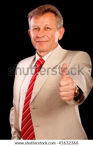Smiling businessman stretches thumb as a sign of end of successful financial operation. - stock photo