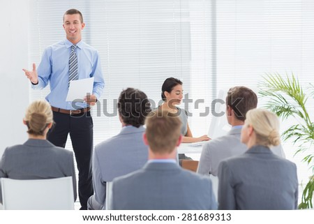 Smiling businessman talking during conference in meeting room - stock photo
