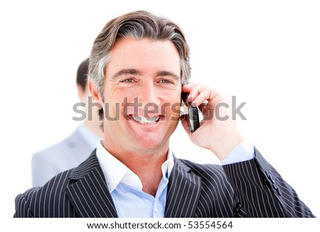 Smiling businessman talking on the phone against a white background - stock photo