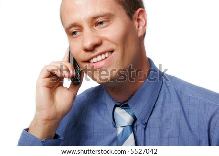 Smiling businessman using his mobile phone, against a white background - stock photo
