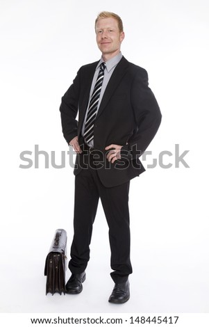 smiling businessman with case - stock photo