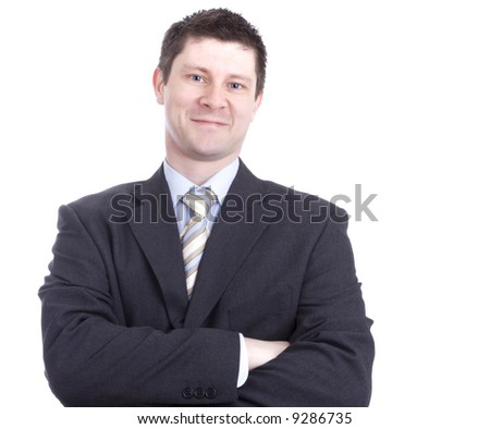 Smiling Businessman with Folded Arms - stock photo